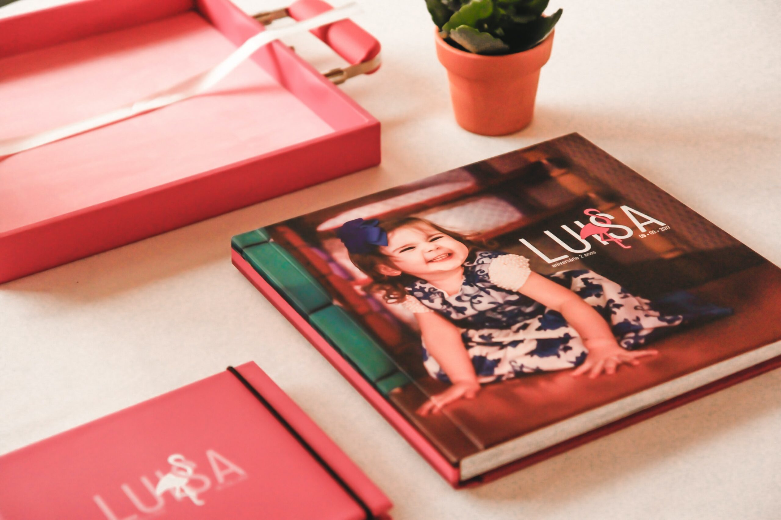 A red photo book on a white table