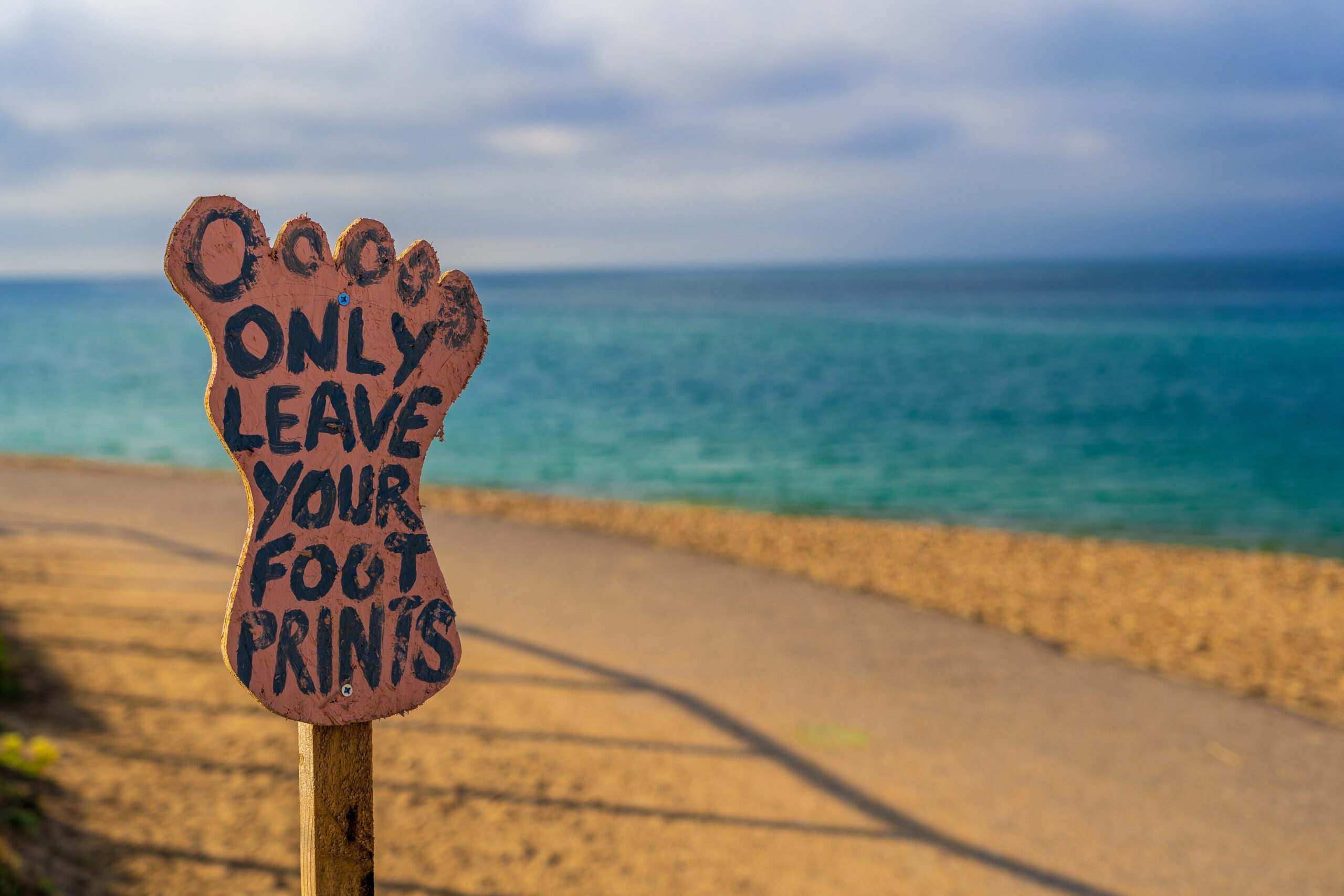 """""""Only leave your footprints"""" sign on a beach in Dorset"""